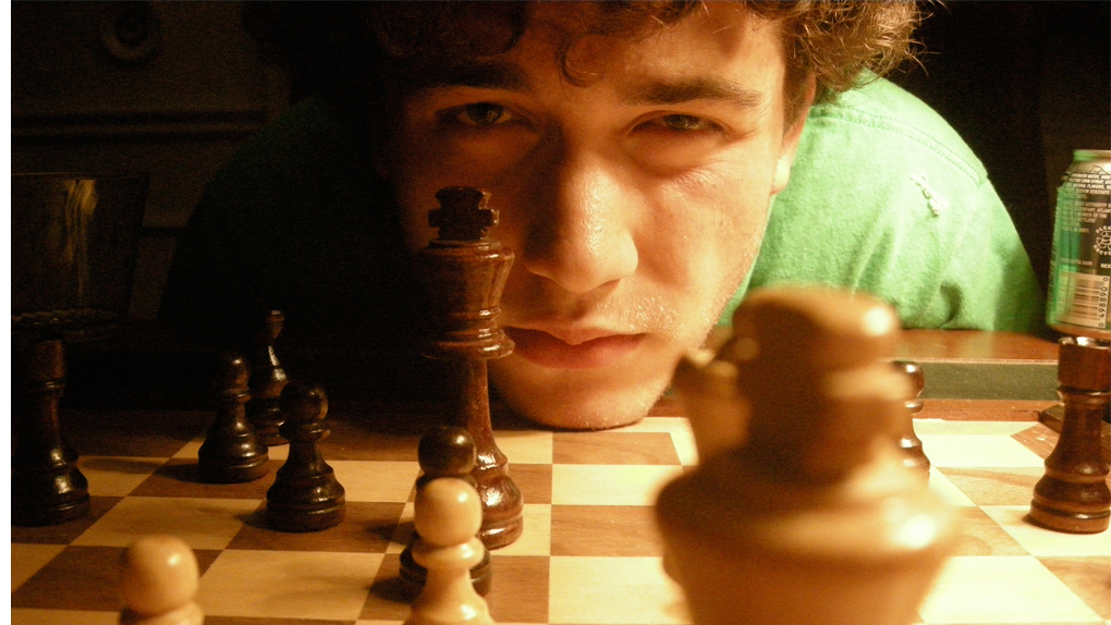 Person plays chess